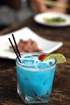:) Blue Curacao, Coconut Rum, & Pineapple Juice.