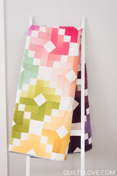 Ombre Gems quilt pattern by Emily of Quiltylove.com.  Colorful ombre   quilt is a jelly roll or fat quarter friendly quilt pattern.  Modern   rainbow quilt using VandCo Ombre fabrics.