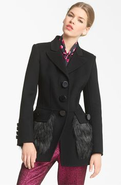 This Marc by Marc Jacobs coat is on the same idea of the Dolce coat. Adding fur just to the pockets won't overwhelm the consumer and is more likely to result in a purchase out the door compared to an all fur ensemble.