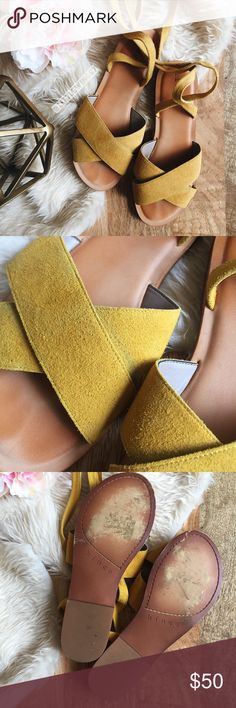 Yellow suede ankle tie sandals Hinge | 'Olivia' ankle tie sandals in Mustard Suede. These gorgeous flats feature wraparound ankle straps and crossover toe straps in a rich goldenrod yellow suede. Bottoms are lightly worn and some discoloration on suede as shown in photos; in otherwise excellent used condition.   Size: 7.5 Hinge Shoes Sandals