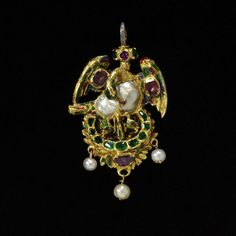 Enamelled gold pendant depicting the Pelican in its piety set with sapphires, emeralds and a baroque pearl, and hung with pearls c1600-1620