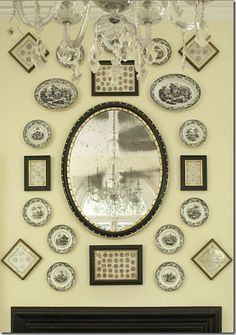 great mix of black transferware plates, and framed art adds so much dimension to this arrangement around a mirror.  Nice!