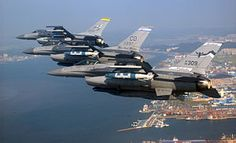 Air National Guard F-16 Fighting Falcon fighters fly over Gunsan, South Korea. The tailflashes denote the aircraft from being from the New Mexico, Colorado and Montana ANGs.