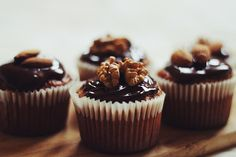 Carrot cake cupcakes with dark chocolate, almonds and...