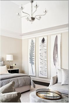 A monochromatic, and very modern bedroom, draws on the animal magnetism and beauty of feathers. Glistening silver and gold accents, from the chandelier, lamp and serving tray, add a touch of sophistication.                                                                                                                                                      More