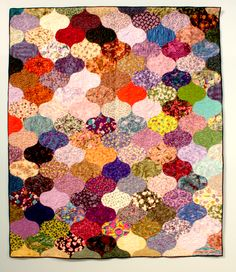 """Bed Quilt - 03. Amanda's Curls made by Susan Voss for her granddaughter Amanda. From Susan: """"My granddaughter Amanda found this pattern online.  She was looking for an edge-to-edge pattern that would make a modern looking quilt.  She is very happy with the results.  It was an interesting challenge and went together like a puzzle."""""""