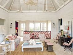 Alessandra Branca's Chic Bahamas Getaway Living Room The living room's vintage armchairs are cushioned in a Bennison print, and the 19th-century campaign chairs are clad in an Alessandra Branca for Schumacher stripe; a Pottery Barn rug is spread across the coral-stone pavers.