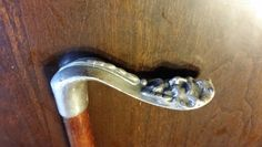 """This cain handle is sterling silver. The look could be a lion or a man. Handle is oak. 36 1/4"""" inches tall"""