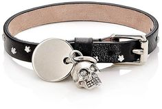 "Alexander McQueen Men's Studded Leather Bracelet Alexander McQueen's wrinkled black leather bracelet is detailed with polished silvertone brass star-shaped studs and dangling charms. Charms include a skull and logo-engraved dog tag. Skull embellished with white Swarovski crystal ""eyes."" Made in Italy."