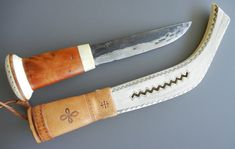 Vintage hand-forged carbon steel Lapp Knife with reindeer antler and raita wood handle with rattle pommel.