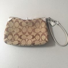 Coach wristlet Coach wristlet.  Has some marks on inside as you can see from pics.  Outside is in pretty good condition but it has been used and loved  Coach Bags Clutches & Wristlets