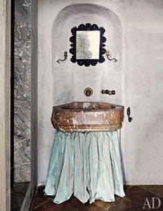 Katia and Marielle Labèque's Apartment and Studio in Rome : Silk taffeta skirts a 19th-century marble basin in Marielle's bath.