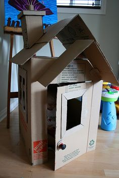 Today we decided to present you some creative and interesting DIY cardboard playhouse ideas. With some really basic and inexpensive materials, a plain cardboard box can be transformed into a stimulating and colorful play house. Cardboard Houses For Kids, Cardboard Box Houses, Cardboard Playhouse, Cubby Houses, Cardboard Crafts, Play Houses, Cardboard Tubes, Cardboard Furniture, Cardboard Gingerbread House
