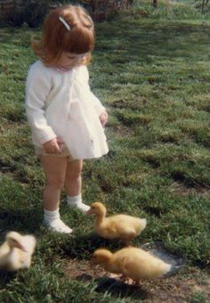 Me at about two years old in the back yard of Maxey Lane house. I got baby ducks for Easter that morning.