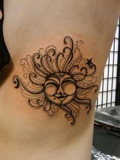 Sun tattoo so cute and different.