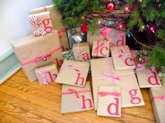 Paper Packages Tied Up With EVERYTHING {including string!} Initials on the Christmas presents! Way cuter than those sticker tags. @ Home Ideas and DesignsInitials on the Christmas presents! Way cuter than those sticker tags. @ Home Ideas and Designs Noel Christmas, All Things Christmas, Winter Christmas, Christmas Presents, Christmas Decorations, Christmas Packages, Handmade Christmas, Christmas Parties, Christmas Paper