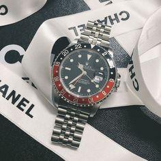 """a 1991 Rolex GMT Master II 16710 """"Coke"""" bezel."""