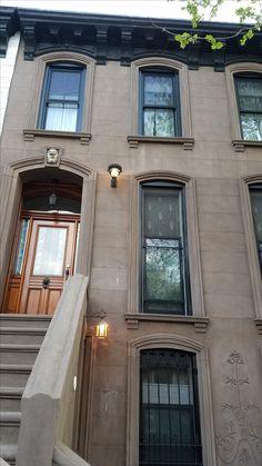 Nice window and cornice and door design (but may clash with neighbors). I like the animal head design above the door. Glowing eyeballs?  Also like the lighting.