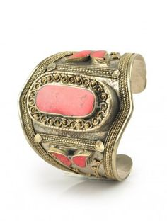 In an attempt to share the same spirit as the women who have traditionally worn it, this Afghan Kuchi coral cuff has been intricately handcrafted.
