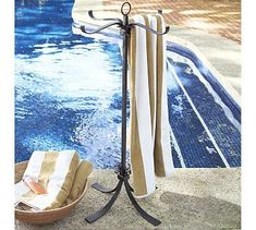 This Towel Storage Valet from Pottery Barn is an interesting way to keep towels off of wet poolsides