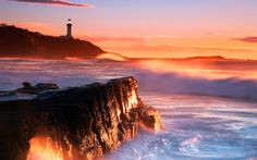 Lighthouse in the distance, a  sunrise here in Nora Point, Australia.