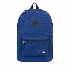 Herschel Supply Co. Twilight Blue & Black Rubber Heritage Backpack : The Twilight Blue / Black Rubber Heritage Backpack is one of Herschel's most popular backpacks. It features a slim silhouette, two simple and straightforward compartments and a mountaineering inspired diamond lash tab. It is constructed from Herschel's custom tear-resistant polyester and an eco-friendly synthetic leather base to further reinforce the base of the bag from drops, impacts and bumps.
