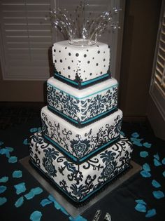 Love the Damask pattern...just switch the turquoise to purple and add a monogram cake topper