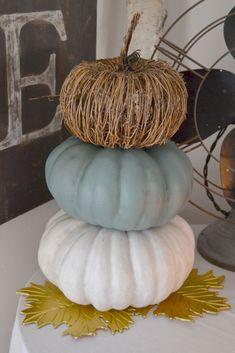 Dollar store pumpkins transformed into a fun pumpkin topiary!