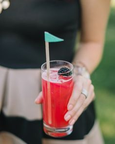 Flagged stir sticks adorned this couple's signature drinks during happy hour. See more of Alex and Brandon's garden-party wedding in San Francisco!