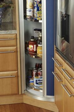 """Now BHG.com Where do I get this???""""Corner Pantry  A sliding pocket door reveals a corner pantry unit, which houses groceries on lazy Susan-style shelves. This solution provides plenty of storage for the kitchen's dry goods."""""""