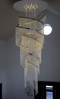 Contemporary Crystal 'Swoosh' Chandeliers Contemporary Chandelier Company is part of health-fitness - health-fitness Crystal Ceiling Light, Crystal Chandelier Lighting, Foyer Chandelier, Luxury Chandelier, Iron Chandeliers, Contemporary Chandelier, Home Lighting, Ceiling Lights, Chandeliers Modern