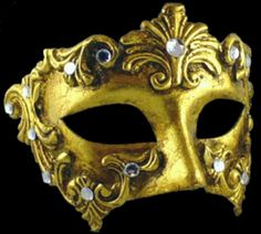 Venetian Masks.   The second one is Columbina. It is a half mask that only covers eyes. There are many gold, silver color and crystals on it. It is tied with ribbon to the head or it can be carried by baton. It is said that it was designed for a character in Commedia Dell'arte, because it is said that she didn't want to cover her beauty.