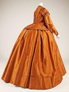 Orange silk visiting dress with self-trim (back), American, 1865-1875.