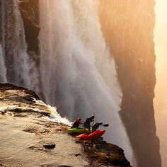 Victoria Falls between the African nations of Zambia and Zimbabwe  http://www.dailymail.co.uk/news/article-2148041/Daredevil-kayakers-paddle-precipice-Victoria-Falls--just-better-look.html Don't try this at home kids! :)