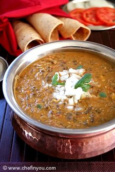 'Dal Bukhara' Recipe - A cousin of the more popular Indian 'Dal Makhani', this recipe can be made richer or simpler as per the occasion demands. This humble stew is made from Indian black lentils and tomatoes.