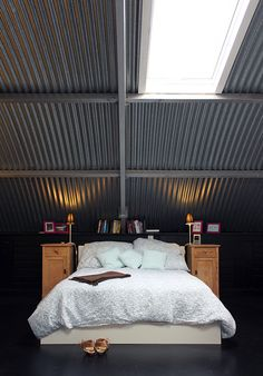 Corrugated metal ceiling gives room dreamlike quality. Attic Bedroom Designs, Attic Rooms, Metal Ceiling, Metal Roof, Ceiling Tiles, Quonset Homes, Casas Containers, Corrugated Metal, Galvanized Metal
