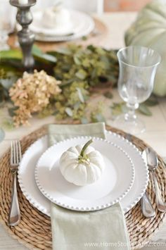 Painted white pumpkin and Pottery Barn plates. I love the dried hydrangeas for fall.