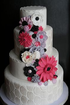 This cake was a work to incorporate the pink gerbera daisy flower and give it a 'girly' feel with the cameo, buttons and flowers.