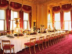 The table in Windsor Castle's magnificent State Dining Room is laid for a Victorian Christmas feast with a magnificent porcelain dessert service by Minton of Staffordshire.  Known as the Victoria Service, the set was purchased by the Queen at the Great Exhibition in 1851 and includes four porcelain figurines of the four seasons, ice pails, cream and bon-bon dishes, and a pair of silver-gilt sauceboats shaped like sleighs.