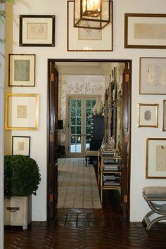 I Need Your Help! Eclectic Gallery Walls - laurel home | beautiful art display around a door by Windsor Smith