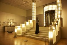 View of the Art Deco 1910–1939 exhibition featuring the foyer from the London Strand Palace Hotel 1930–31 (designed by Oliver Bernard) and evening jacket with green collar, summer 1929 (from the couture house Jeanne Lanvin, Paris) Museum Victoria, Melbourne
