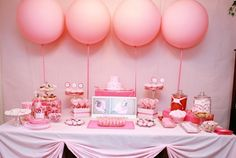Cute way to pin table cloth. GREAT list of pink treats below the pic on the original post.