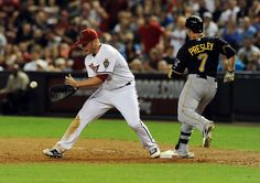 PHOENIX, AZ - APRIL 17: Alex Presley #7 of the Pittsburgh Pirates beats out a throw at first base as Lyle Overbay #37 of the Arizona Diamondbacks waits for the ball at Chase Field on April 17, 2012 in Phoenix, Arizona. Pittsburgh won 5-4. (Photo by Norm Hall/Getty Images)