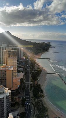 Morning view of Diamond Head & Waikiki Beach in Hawaii. The Aston Waikiki Circle Hotel is bottom left.