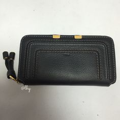 """CHLOE MARCIE LONG ZIP AROUND WALLET Authentic like new Chloe Long Ziparound Wallet in black pebbled leather. Decorative stitching & piping. Logo-embossed front. Zip around closure. Interior zip & currency pocket with 12 card slots. Contrast leather interior. Approx 7.5""""W X 4""""H X 1""""D ❌❌NO TRADES NO PP PLEASE DO NOT ASK❌❌ Chloe Bags Wallets"""
