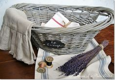 "How to create a pretty French inspired gray basket: "" ...spray painted it with Rust-oleum Camouflage paint…a nice beigey-greyish color. Once that dried, she added a wash (half paint, half water) of Behr Sparrow."" from Confessions of a Plate Addict"