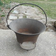 """(1). Cast iron Brazier. 1770-1820.Removable internal grate is missing. this form was popular on shipboard, as well as in 19th century wagon trains. Also the later versions had straighter sides. H: 8 1/2""""."""