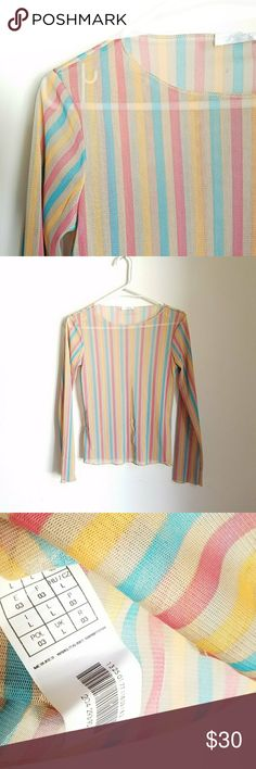 Vtg Y2K rainbow striped imported French mesh tee Vintage Y2K imported French rainbow striped colorful mesh semisheer long sleeve stretchy top. It gives such cool bare skin / naked look  Size L. Will fit S-M best. (Check measurements provided to ensure fit).  These tops are such troppers: they look great paired with strappy bralettes, under solid tees (for a tattoo sleeves inspo look), camis, satin dresses, overalls, pinafores... literally anything for a grunge witchy look. They are super…