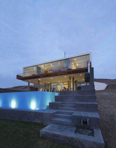 Modern Beach House contours following the sloped terrain.