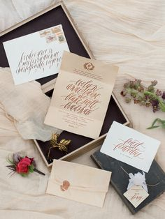 Let whimsical calligraphy take center stage in rose gold foil set against a neutral background. This wedding invitation suite sets the tone for a romantic fete.
